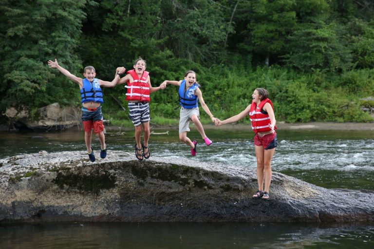 Smyth County Outdoor Adventure Kids jumping in a river